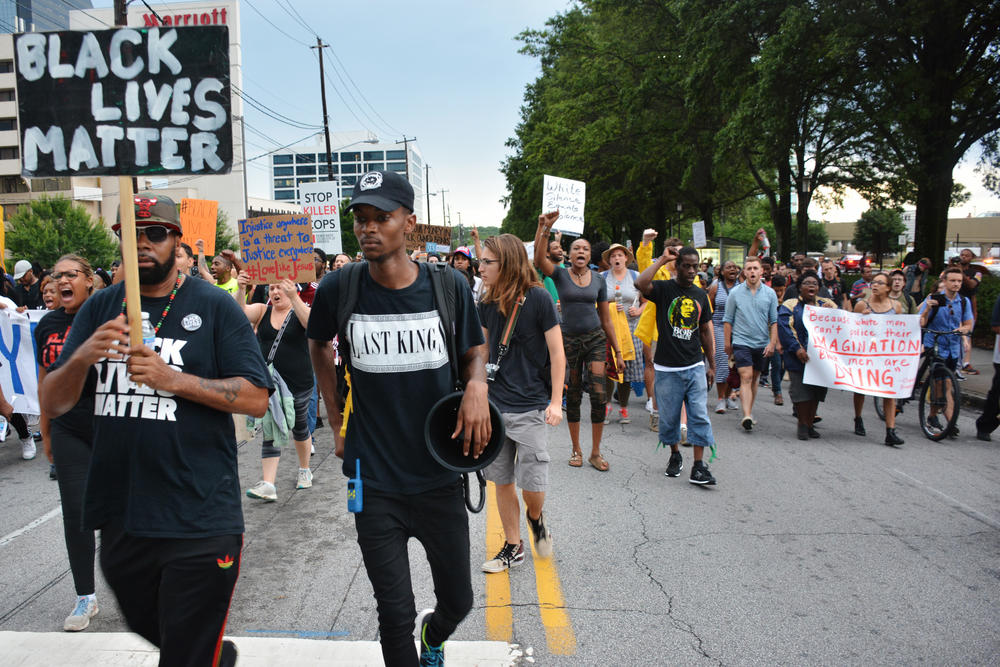 Protesters marching up Lenox Road in Atlanta's Buckhead neighborhood Monday.