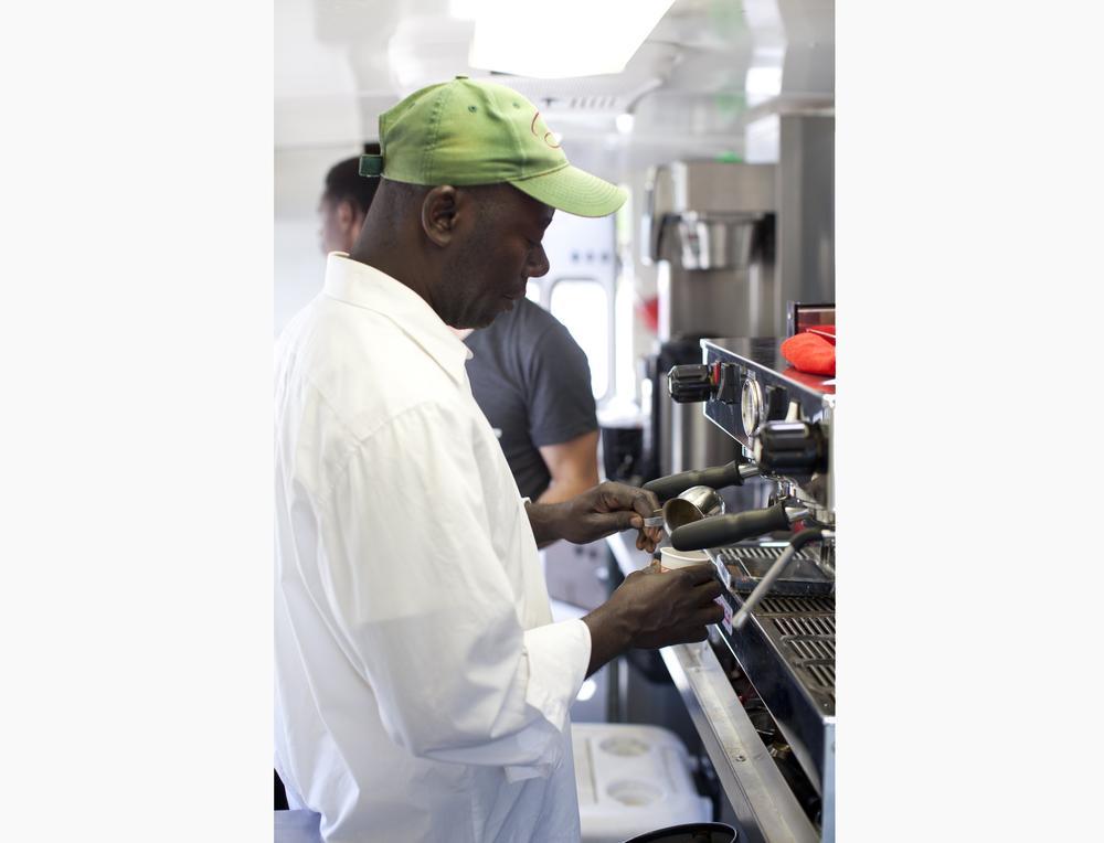 Leon Shombana prepares espresso for Refuge Coffee's customers.