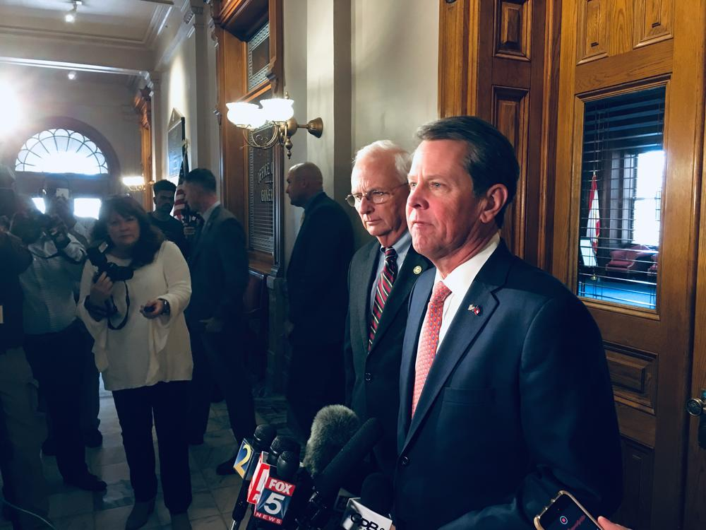Gov. Brian Kemp and Agriculture Commissioner Gary Black speak to reporters Feb. 27.