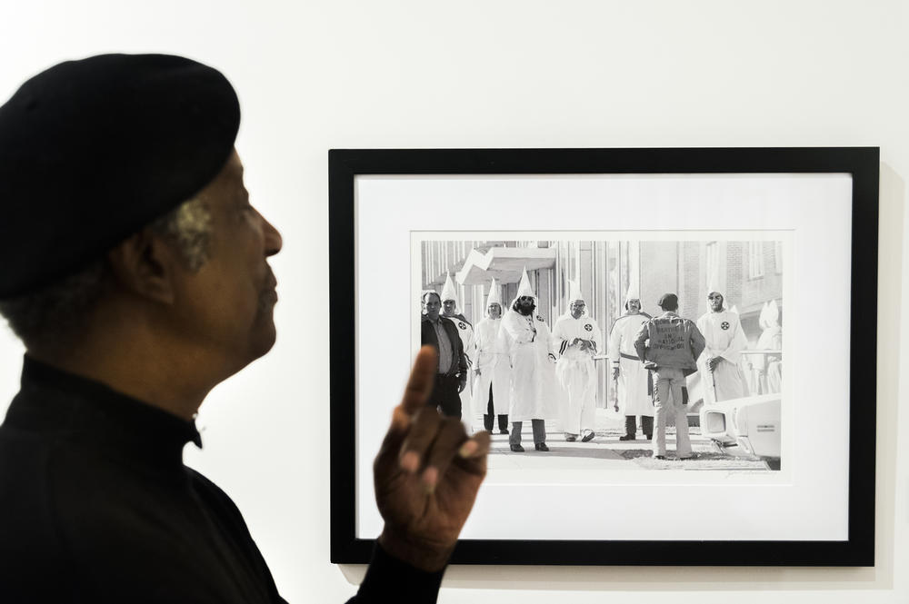 Jim Alexander with an image of an Ku Klux Klan protester facing down Klan members during a rally in Tupelo, Miss. in 1978. This image and others were used to prosecute Klan members who assaulted protesters.