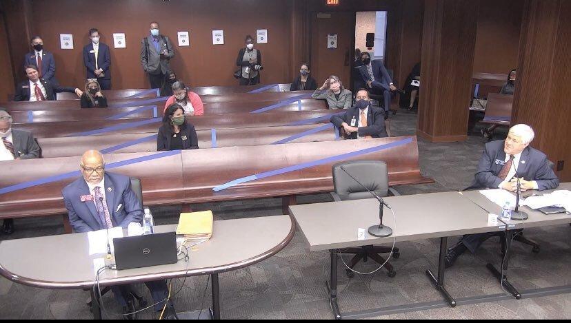 Legislators social distance at a hearing on hate crime legislation in the state House.