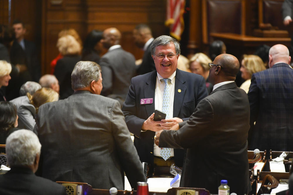 Georgia State House Rep. Rick Jasperse talks with colleagues during the first day of the year for the general session of the state legislature, Monday, Jan. 13, 2020, in Atlanta.