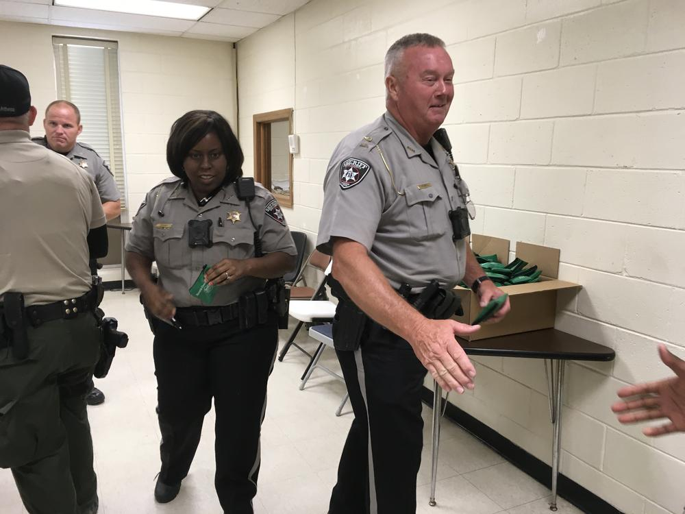 Bibb County Sherriff's Officers receive their Narcan kits after training class