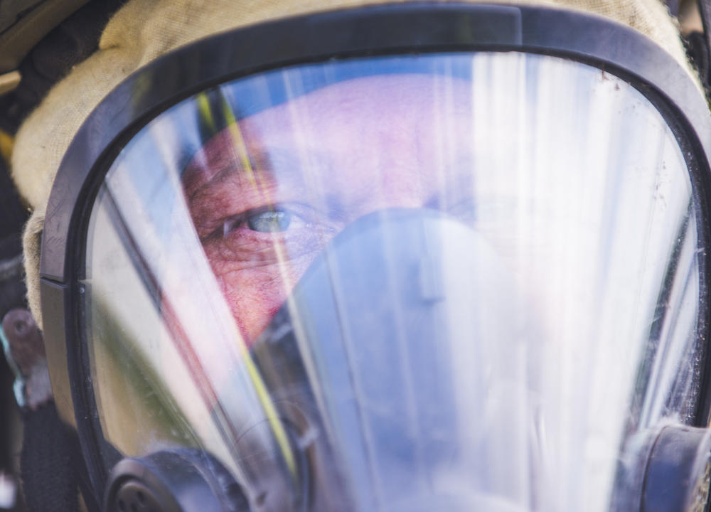 Firefighter David Foxworth in his respirator during a training demonstration.