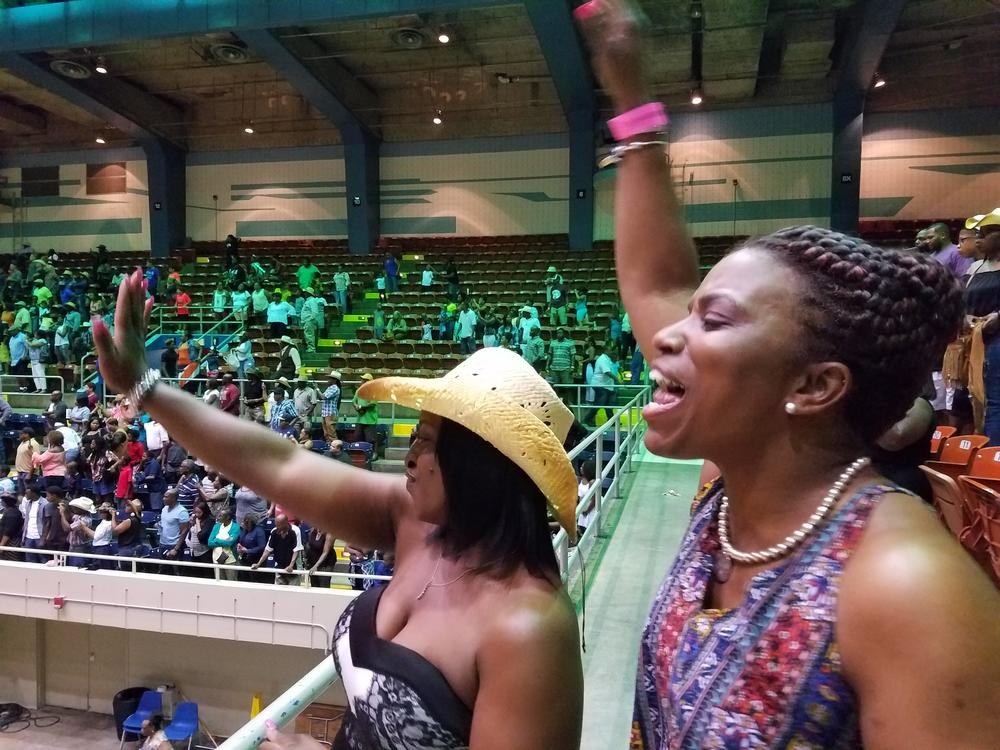 Reeshemah Johnson (left) and Ramona Famble cheer at the Southeastern Rodeo Association's July rodeo in Savannah, Ga., billed as the city's first black rodeo.
