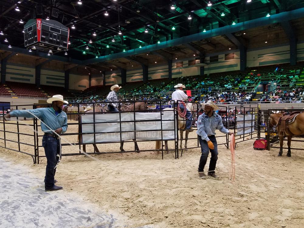 A pair of cowboys practice their roping skills - on each other