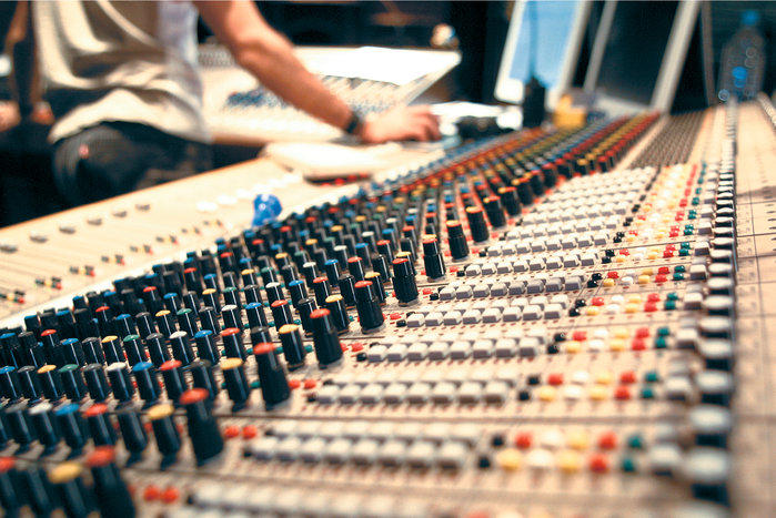 A mixing console inside a recording studio