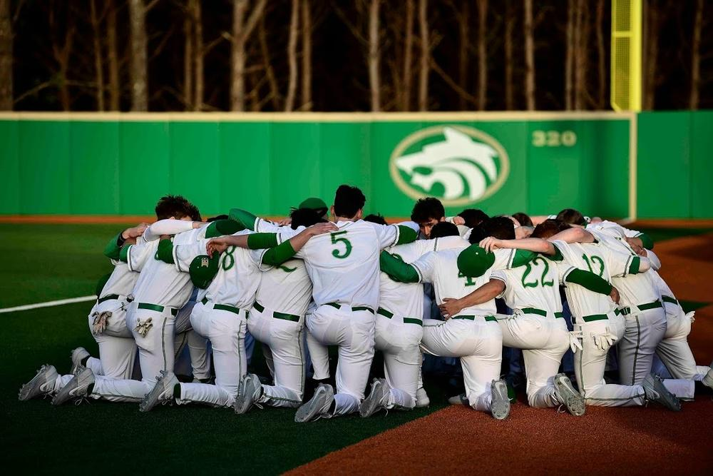 The Buford highschool baseball team huddles together before a game