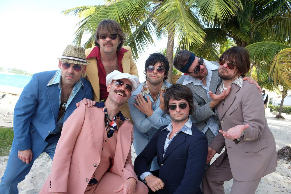 The members of Yacht Rock Revue pose on the beach. Their 9th Annual Yacht Rock Revival is on Aug. 24 at Chastain Park.