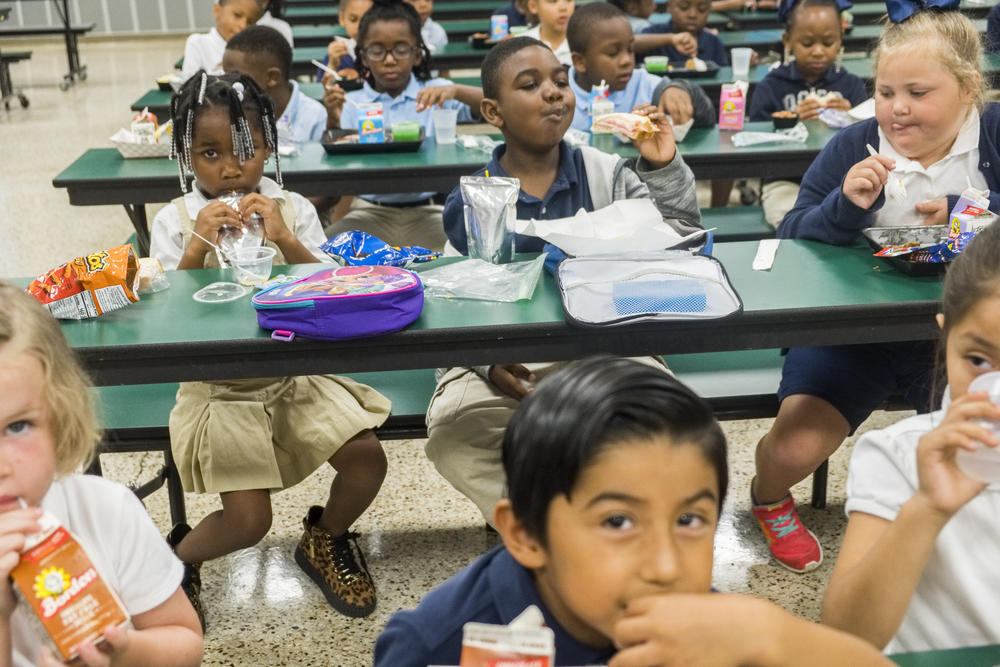 Students at International Studies Elementary Charter School during their lunch period. International Studies is one of 10 Doughterty County schools participating in the Helpings Hands Ending Hunger program.