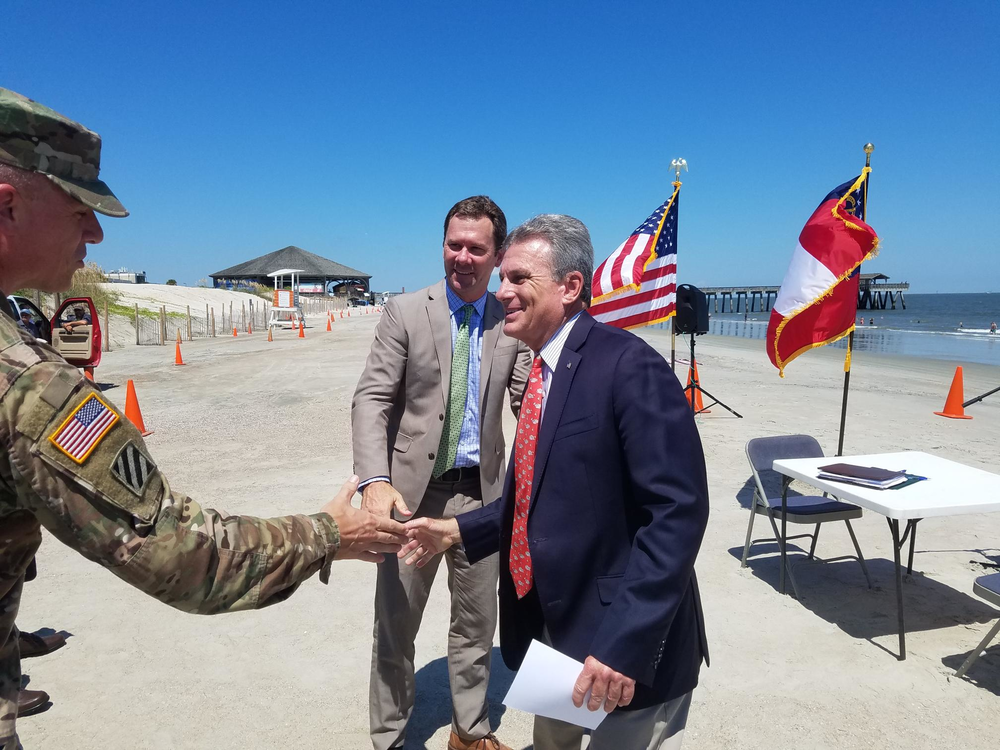 Corps of Engineers Savannah District Commander Col. Daniel Hibner shakes hands with Congressman Buddy Carter (right) and Tybee Mayor Jason Buelterman