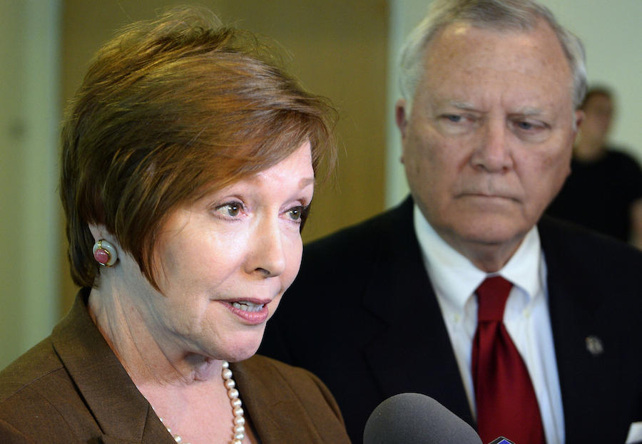 In this Oct. 16, 2014 file photo, Brenda Fitzgerald, Georgia Department of Public Health commissioner, left, and Georgia Gov. Nathan Deal respond to questions in Atlanta.