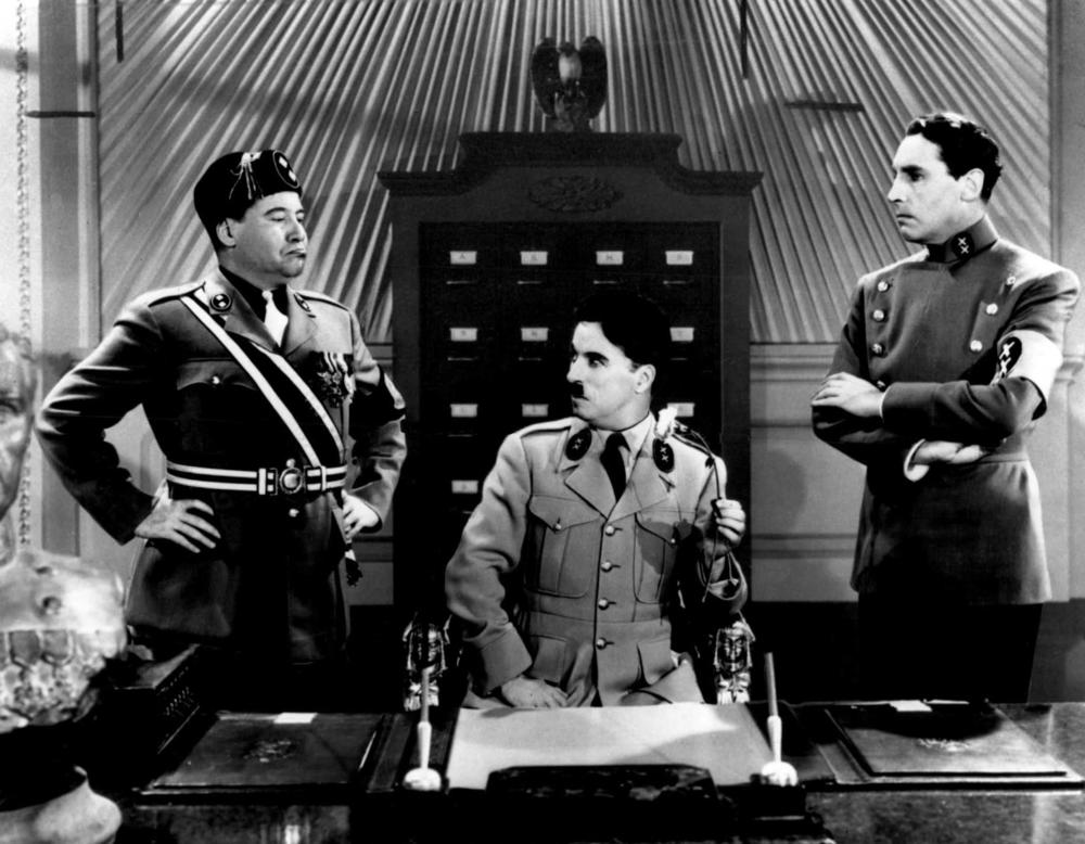 "Actor Charlie Chaplin is seen in the film ""The Great Dictator,"" as Adenoidal Hynkel, center, and Jackie Oakie as Napaloni, left, and Henry Daniell as Garbitsch, 1940."
