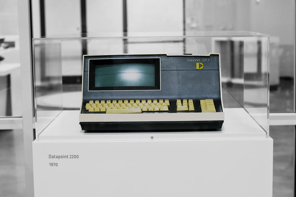 A Datapoint 2200 computer sits in a plexiglass case at the start of a technology timeline in the Computer Museum of America. The new Roswell attraction occupies 44,000 sqaure feet in an old Burlington Coat Factory building in a suburban strip mall.