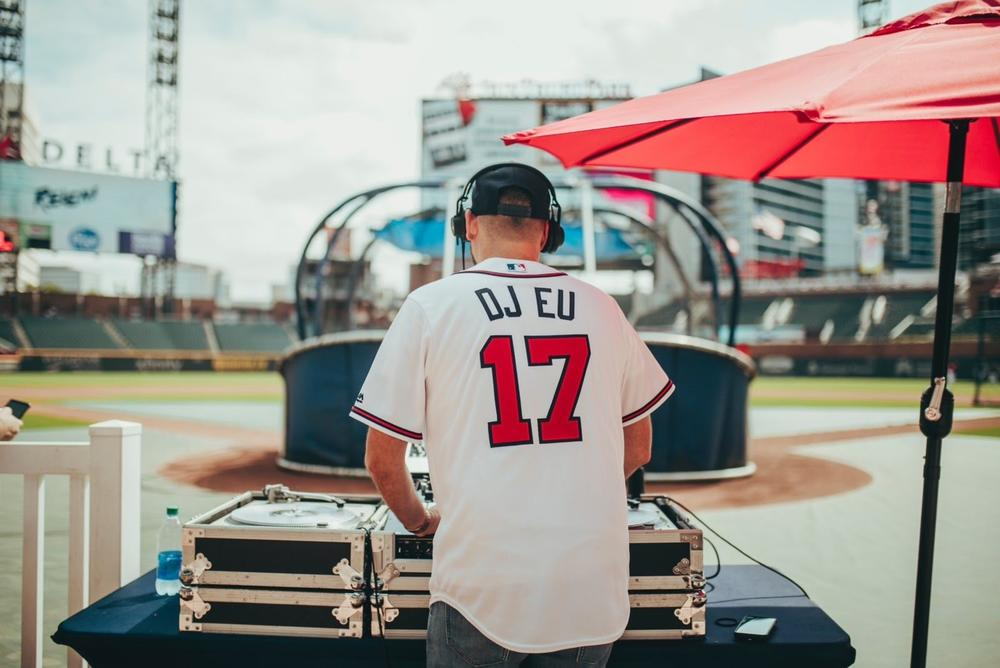 DJ EU plays at Atlanta Braves event.