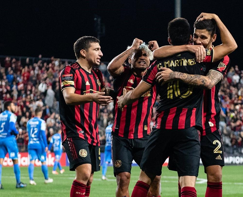 Atlanta United players celebrate a goal en route to a 3-0 over Motagua during the second leg of a Round of 16 matchup in the CONCACAF Champions League on Feb. 25, 2020.