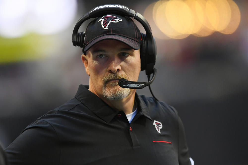 Atlanta Falcons head coach Dan Quinn stands on the sidelines during the first half of an NFL football game against the Seattle Seahawks, Sunday, Oct. 27, 2019, in Atlanta.