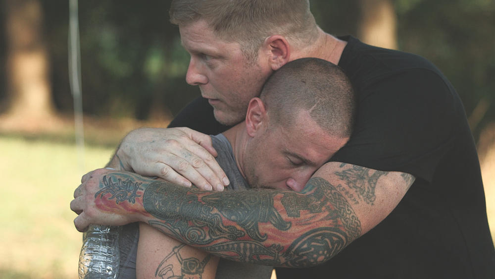 Chris Buckley (left) of the Grand Knighthawk for the North Georgia White Knights and peace activist Arno Michaelis (right) in a scene from the now canceled A&E series,  Escaping the KKK: A Documentary Series Exposing Hate in America.