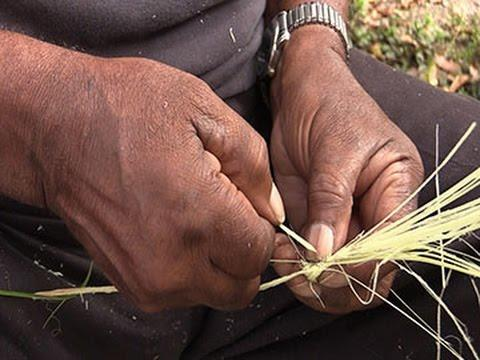 Sapelo Island resident makes a traditional Gullah basket.