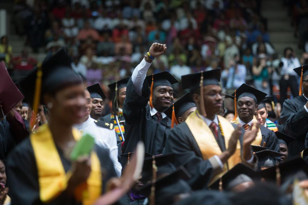 A student in the audience waves during first lady Michelle Obama's remarks for the Tuskegee University Commencement ceremony in Tuskegee, Ala., May 9, 2015