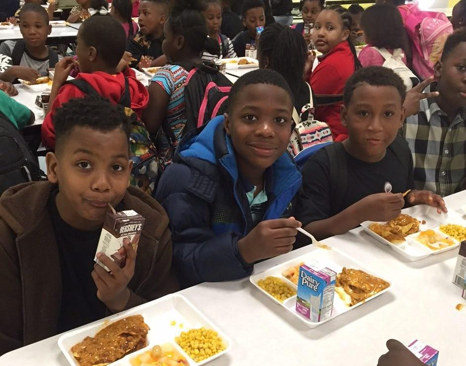 Children eat at the Reconstructing Youth Foundation in Tyrone, Georgia.