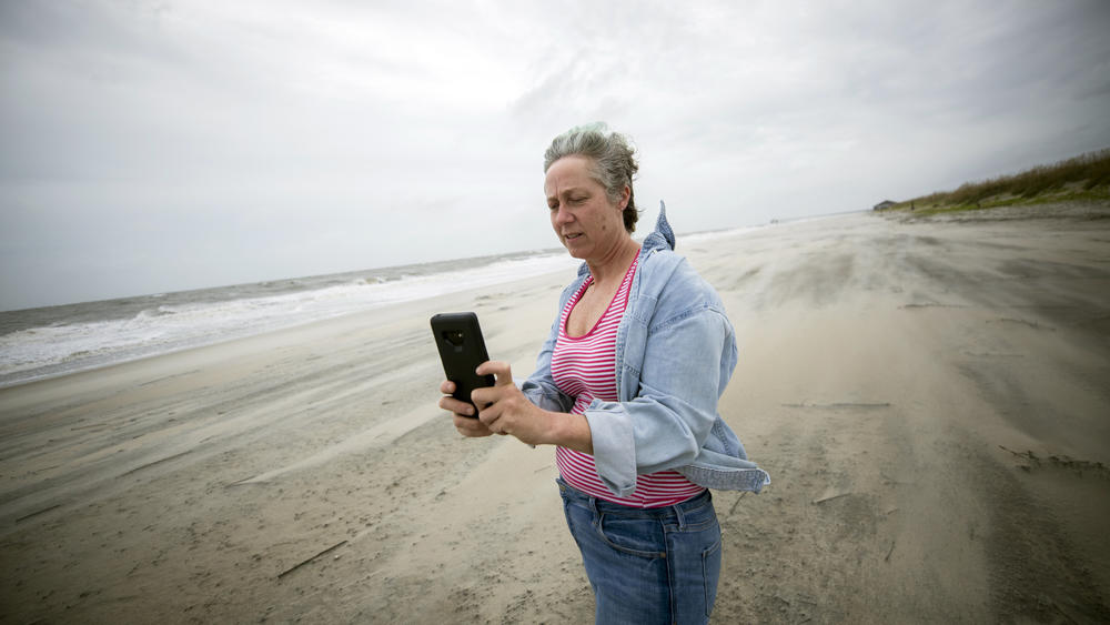 Crystal Travaille takes a cell phone photo of the wind and seas on the beach as Hurricane Dorian makes its way up the East Coast.