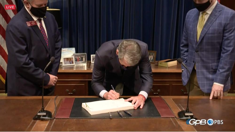 Gov. Brian Kemp signs the FY21 budget.