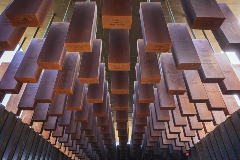 800 steel columns inside of the National Memorial For Peace and Justice in Montgomery, Ala. The columns recognize the names of lynching victims.