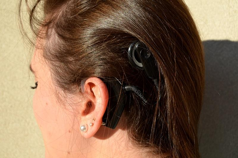 Emory University student Morgan Leahy got a cochlear implant to help with her hearing loss, but she says it's not a replacement. She describes the sound as hollow and robotic, and she has to strain to make out certain words and sounds.