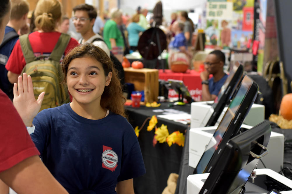 Camilla Negron, a 15-year-old student at Jenkins High School in Savannah, demonstrates the new Dominion touchscreen ballot-marking device voting machine at the Georgia National Fair in Perry.