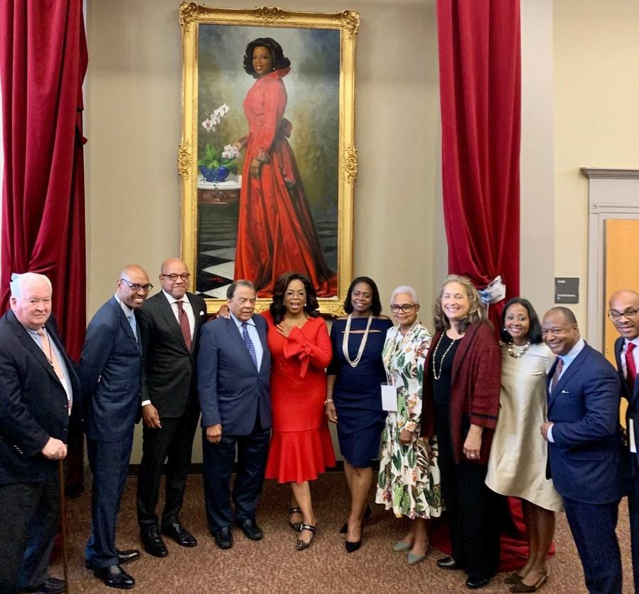 Winfrey poses in front of a painting of her likeness. The portrait was unveiled on Monday at Morehouse College in Atlanta