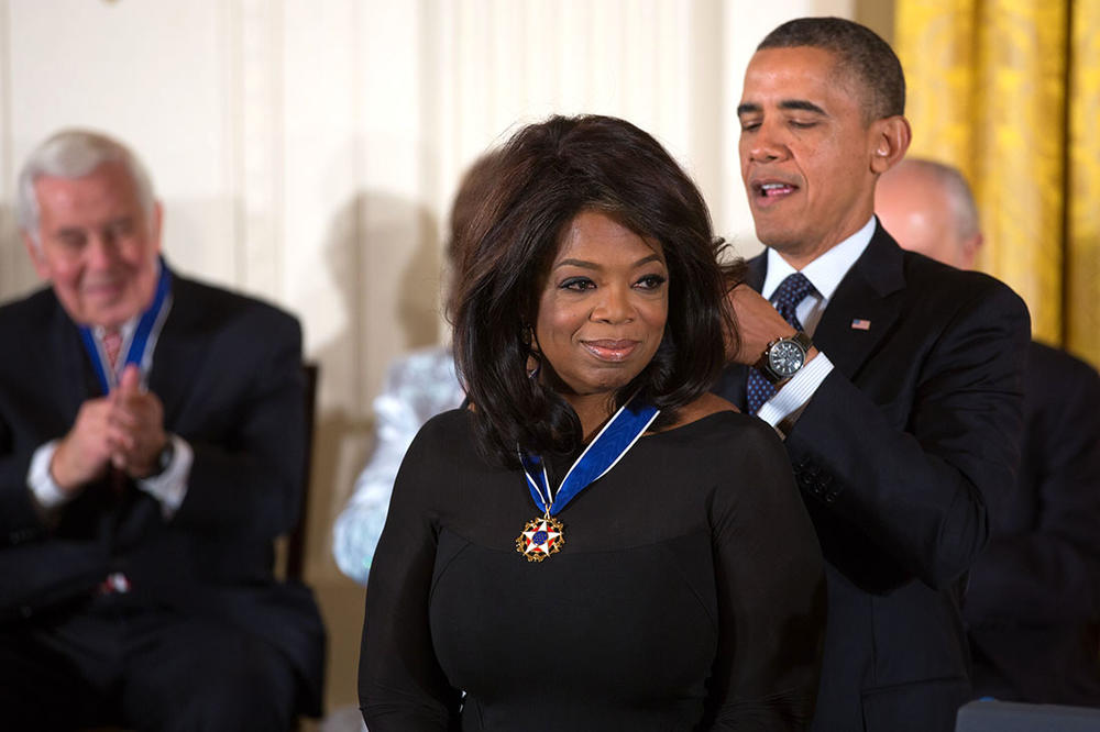President Barack Obama awards the 2013 Presidential Medal of Freedom to Oprah Winfrey during a ceremony in the East Room of the White House, Nov. 20, 2013.