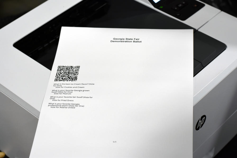 Georgia's new ballot-marking device voting system adds a paper component. This piece of paper, which contains a QR code and a textual summary of the races and a voter's selection, is then inserted into a scanner to be counted and stored.
