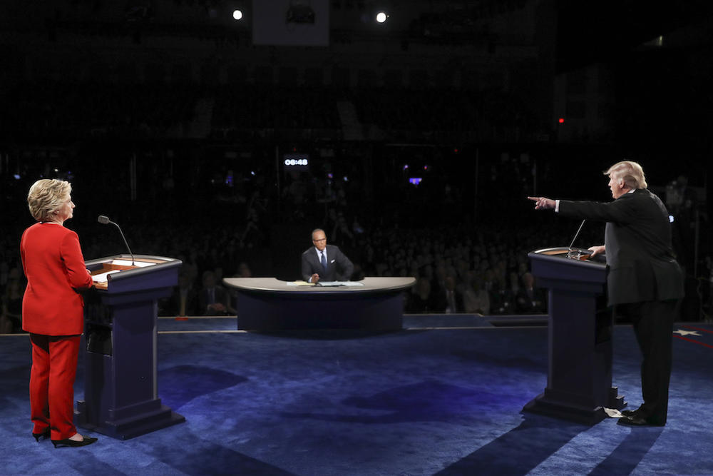 Republican presidential nominee Donald Trump points toward Democratic presidential nominee Hillary Clinton during the presidential debate at Hofstra University in Hempstead, N.Y., Monday, Sept. 26, 2016.