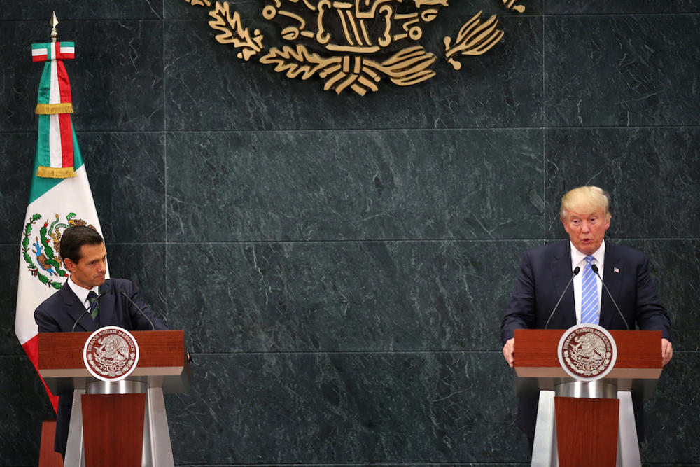 Republican presidential nominee Donald Trump, right, speaks during a joint statement with Mexico President Enrique Pena Nieto, left, at Los Pinos, the official presidential residence, in Mexico City, Wednesday, Aug. 31, 2016.