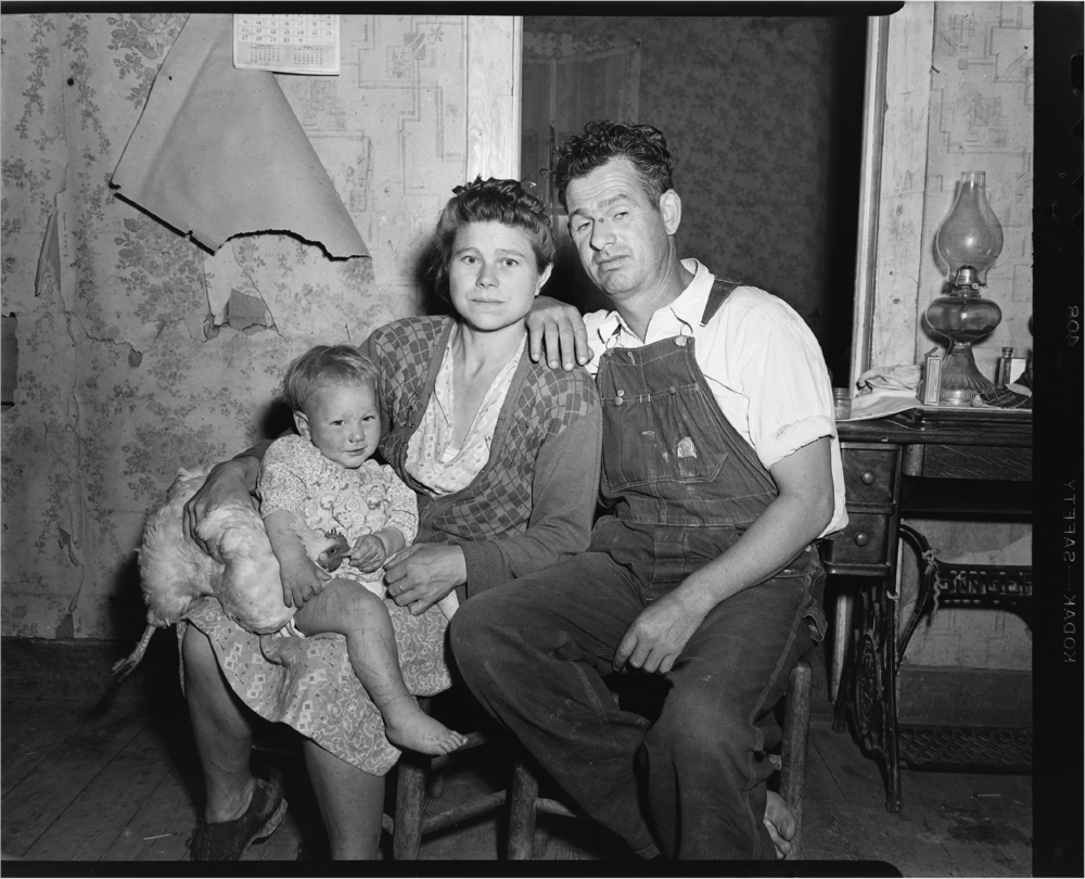 In a photo from the Shipp Studio Archive, chicken (left), daughter, mother and father sit for their portrait in rural Tennessee.