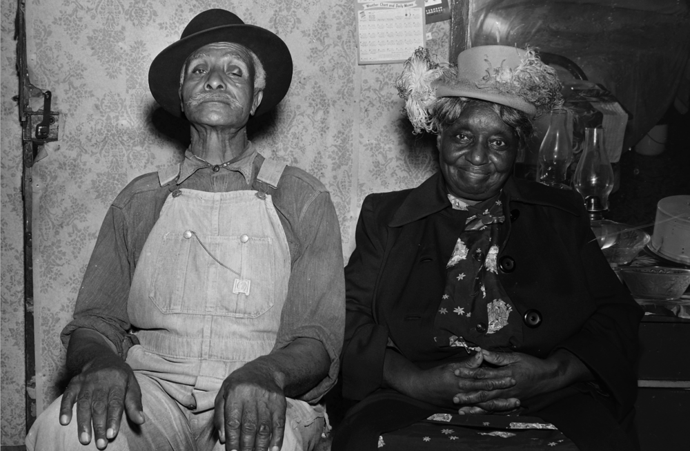 In a photo from the Shipp Studio Archive, a man and woman sit for their portrait in rural Tennessee.