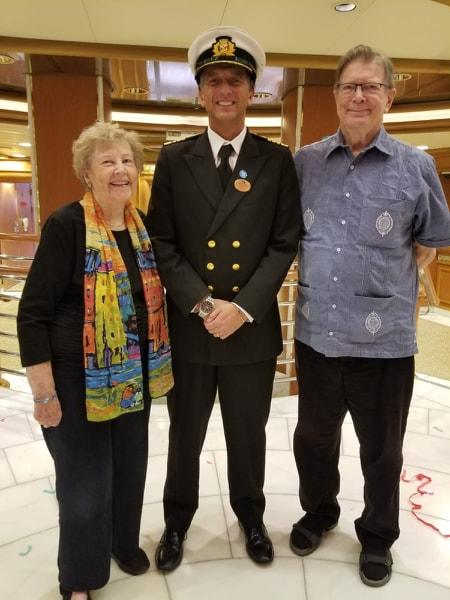 Renee (left) and Clyde Smith with the cruise ship captain as they renewed their wedding vows aboard the Diamond Princess.