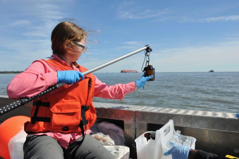 St. Simons Sound Incident water quality team member Laura Hassold Prévot, environmental scientist, retrieves a water sample from the St. Simons Sound. Altamaha Riverkeeper and UGA are doing their own, separate, collection and testing.