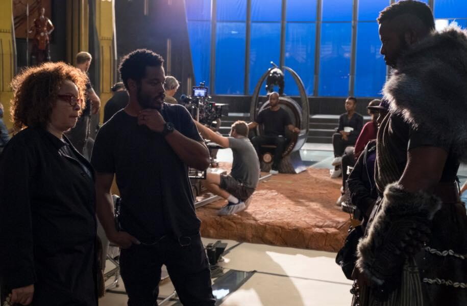 Qualen Bradley sitting in for Chadwick Boseman on set of Black Panther with director Ryan Coogler in the foreground.