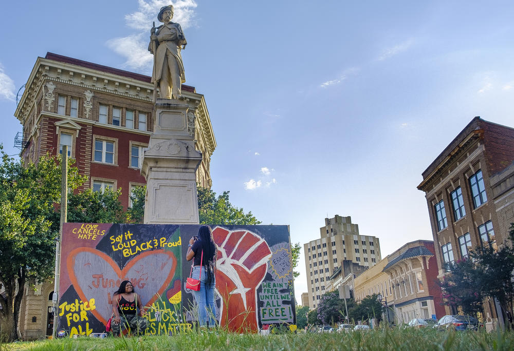 In Macon, activists surrounded the base of a Confederate monument with a box to serve as a canvas for Black art.