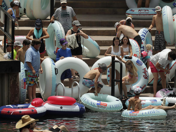 Tubers prepare to float the Comal River in New Braunfels, Texas, on June 26. Texas Gov. Greg Abbott said that the state is facing a