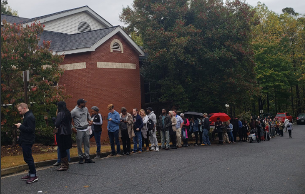 Voters wait in line at a polling place in Vinings.