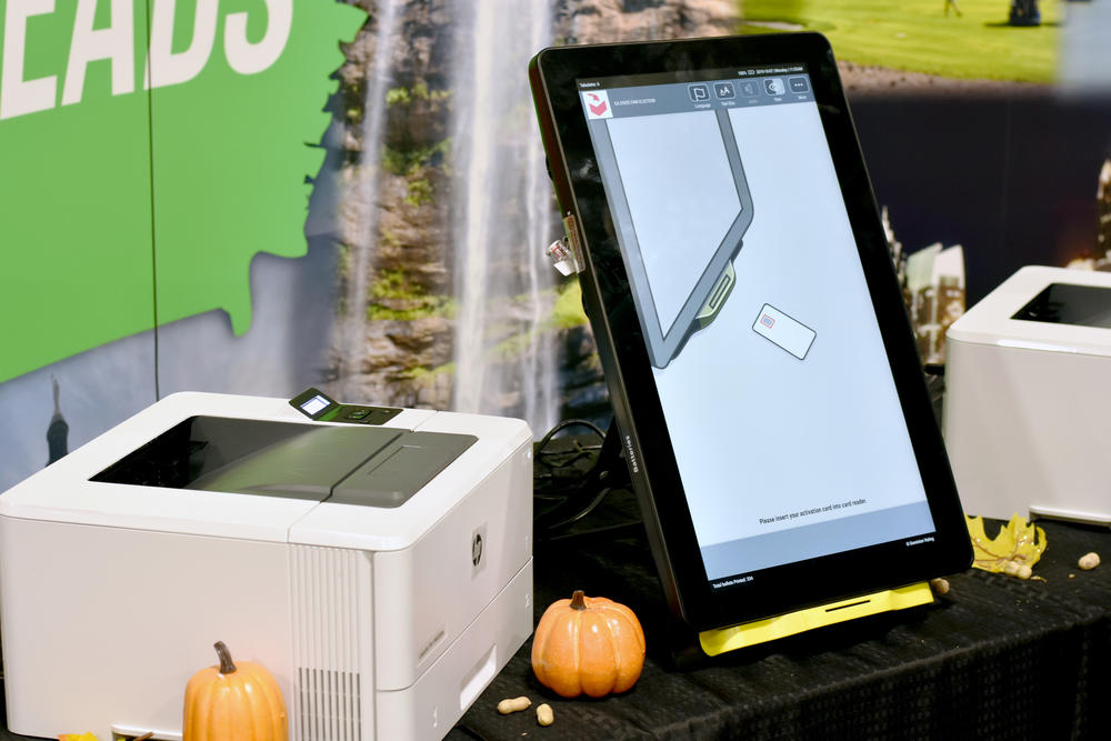 A Dominion ballot-marking device is set up at the Georgia National Fair in Perry. Voters will make their selections on the touchscreen machine, which will print out a paper ballot with a QR code and a text summary of the races and selections made.