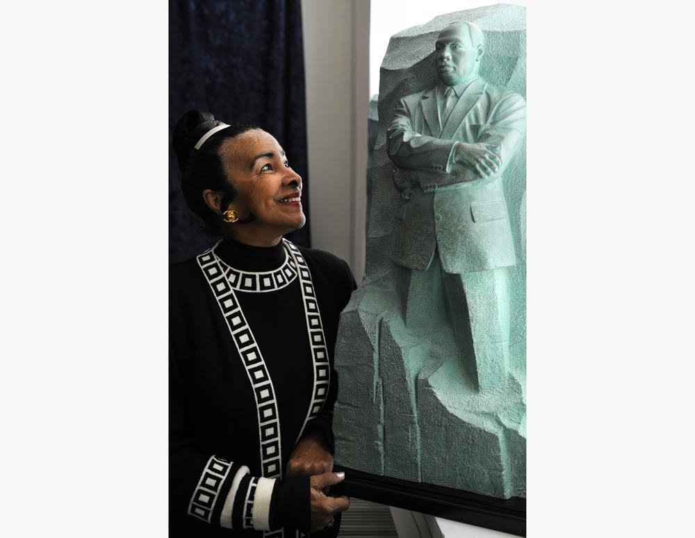Xernona Clayton, who was a special assistant to Martin Luther King, Jr., looks at a model of the Stone of Hope, the centerpiece of the Martin Luther King, Jr. National Memorial Project.