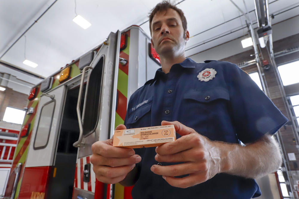 Fire medic Paul Drouhard shows a box containing naloxone that is carried in all the department's emergency vehicles. The drug commonly called Narcan is used primarily to treat narcotic overdoses.