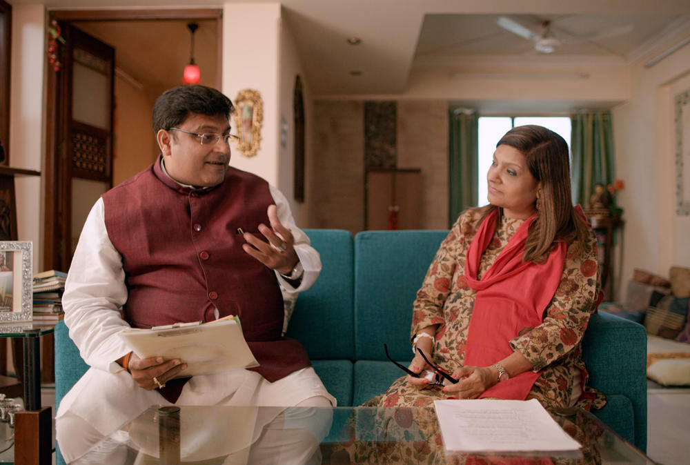 Sima Taparia (right) is a jet-setting matchmaker from Mumbai. Here she confers with astrologer Pundit Sushil ji, who helps her come up with prospective mates for her clients.