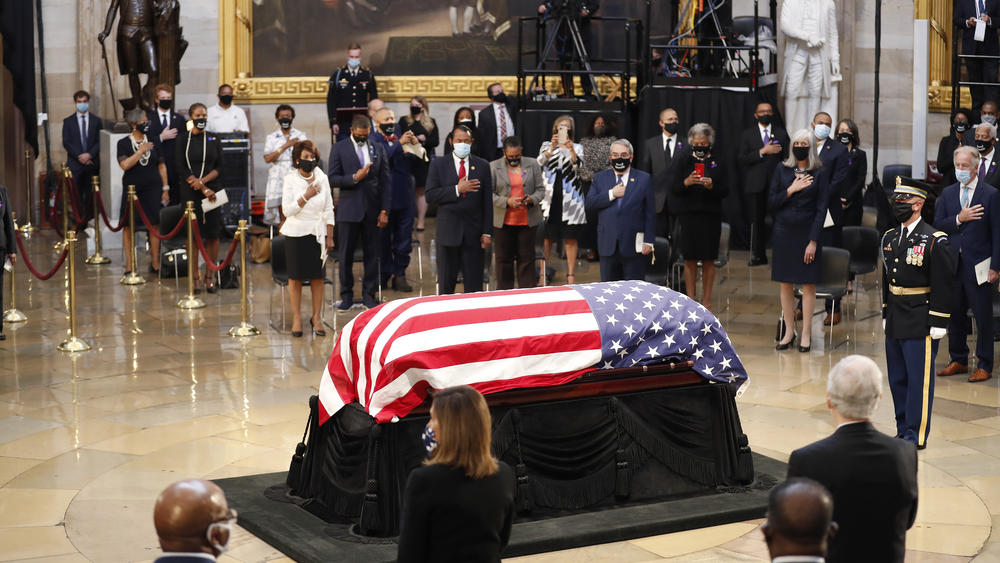 Lewis' flag-draped coffin lies in state Monday in the Capitol Rotunda.