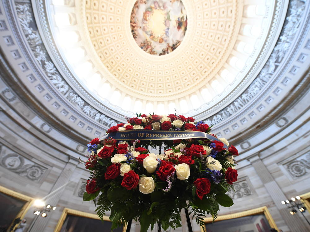 A wreath is shown before the start of a memorial service Monday for Lewis in the Capitol Rotunda.