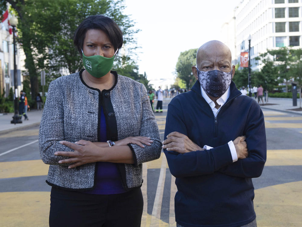 Washington, D.C., Mayor Muriel Bowser and Lewis look over a section of 16th Street renamed Black Lives Matter Plaza on June 7 in the nation's capital. It was the congressman's last public appearance.